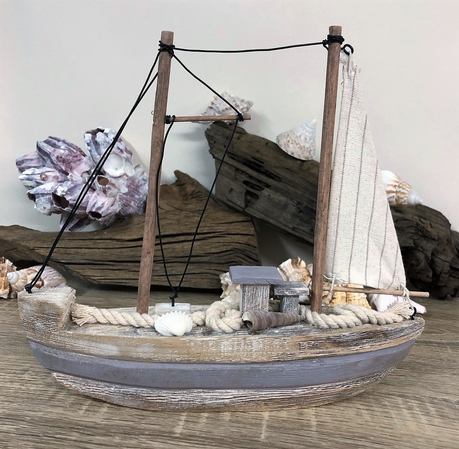 Natural Finish Wooden Boat With Shells